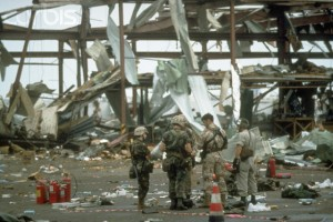 American Military personnel work at the site in Dhahran, Saudi Arabia where a warehouse was hit by an Iraqi Scud missile
